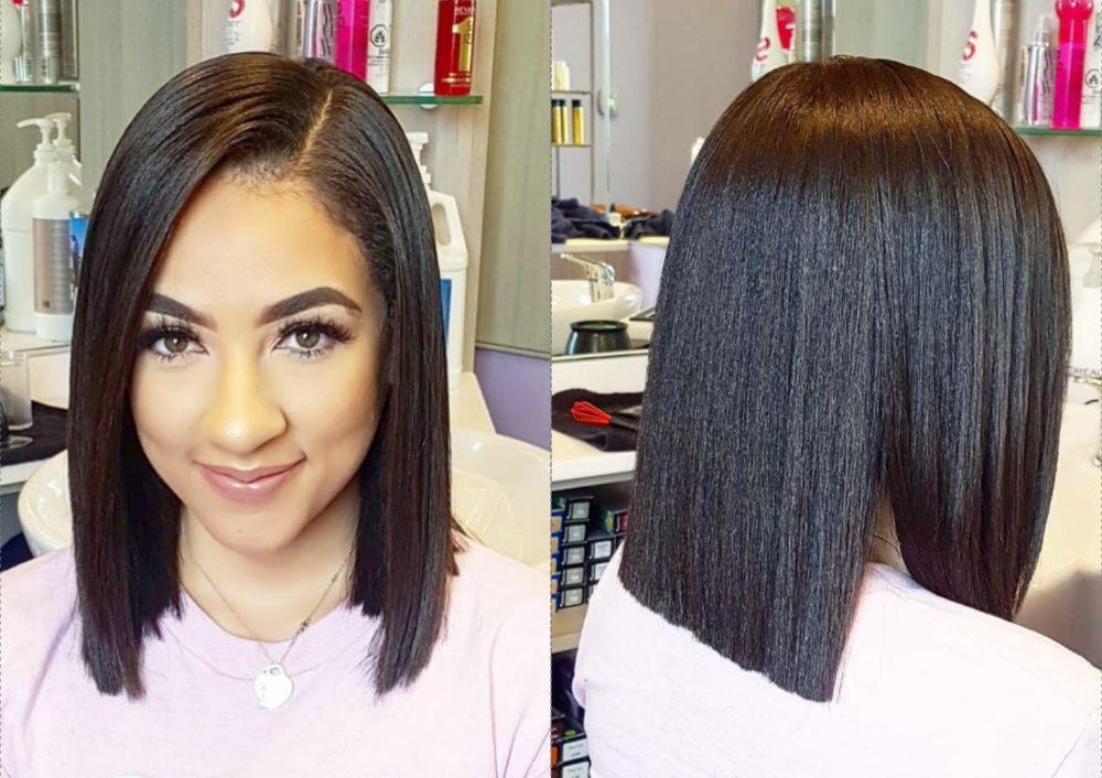 This shinny very dark Brown color long Bob blunt hair cut by