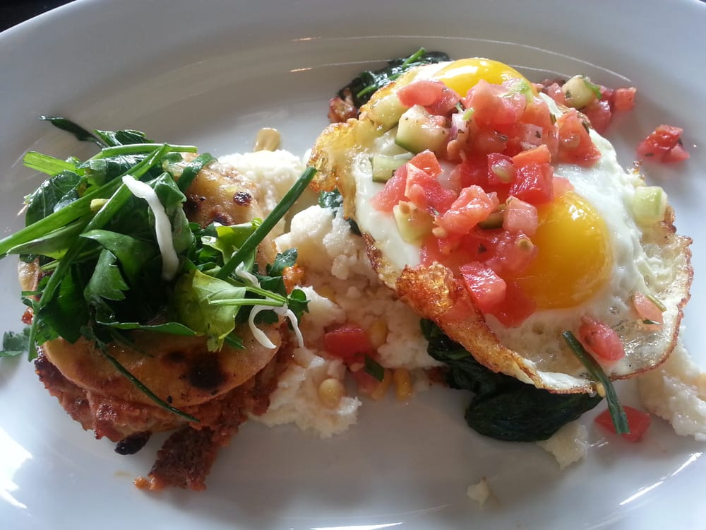 Cheese And Chorizo Pupusas With Corn Grits Sauteed Spinach And Two Fried Eggs Divine Yelp
