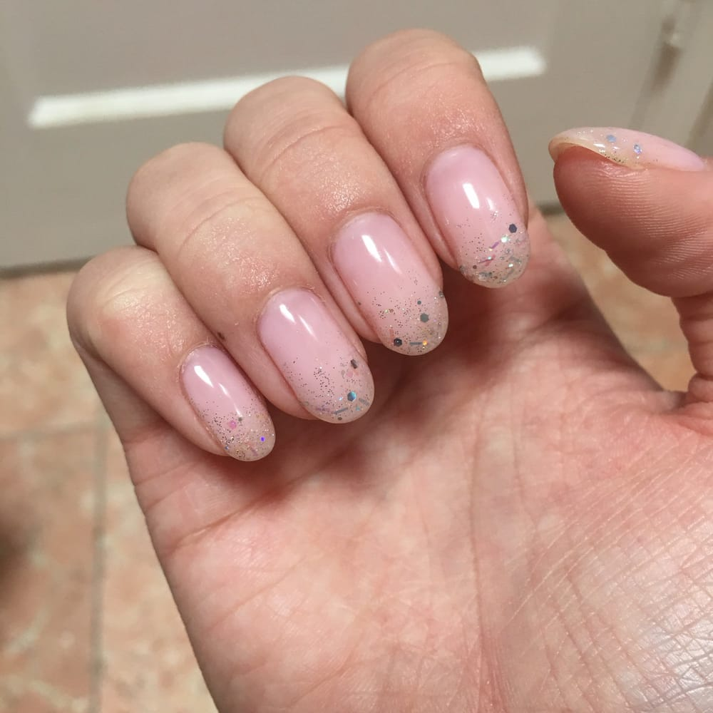 Super cute gel manicure! She used two different types of glitter ...