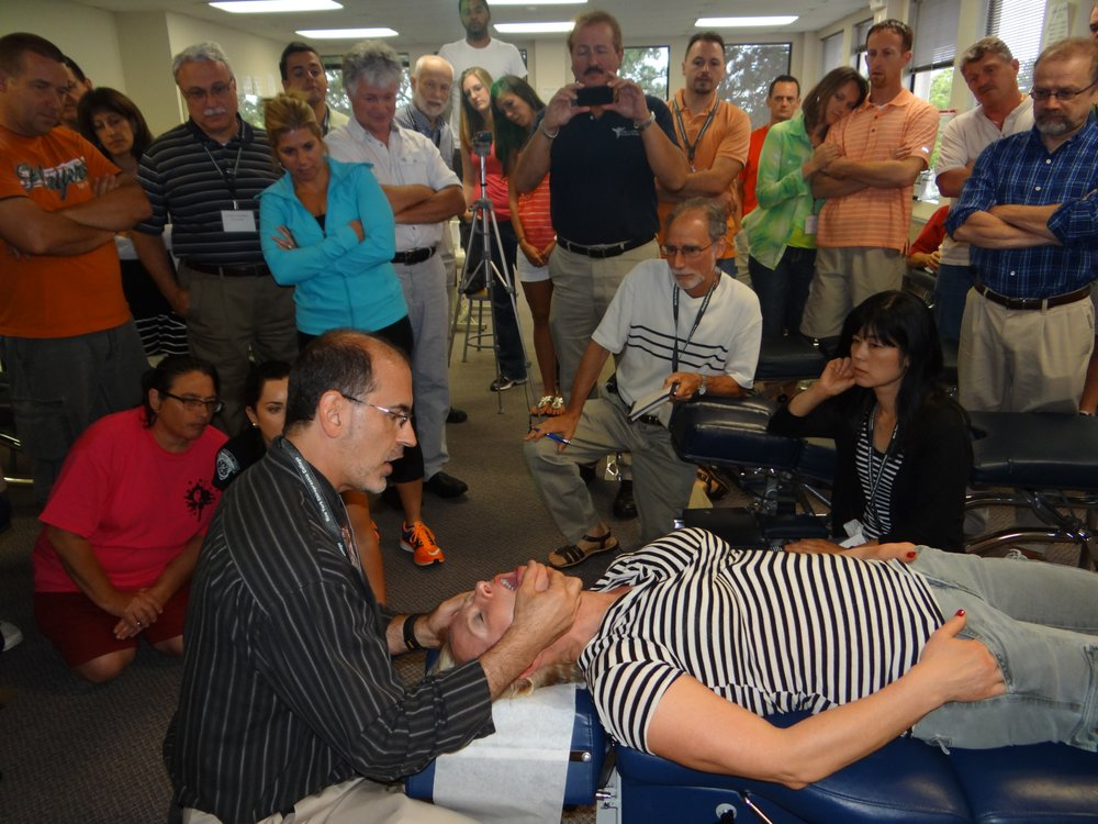 Photo of David Graber, DC - Parsippany, NJ, United States. Teaching NY Chiropractors how to examine the TMJ (Jaw).
