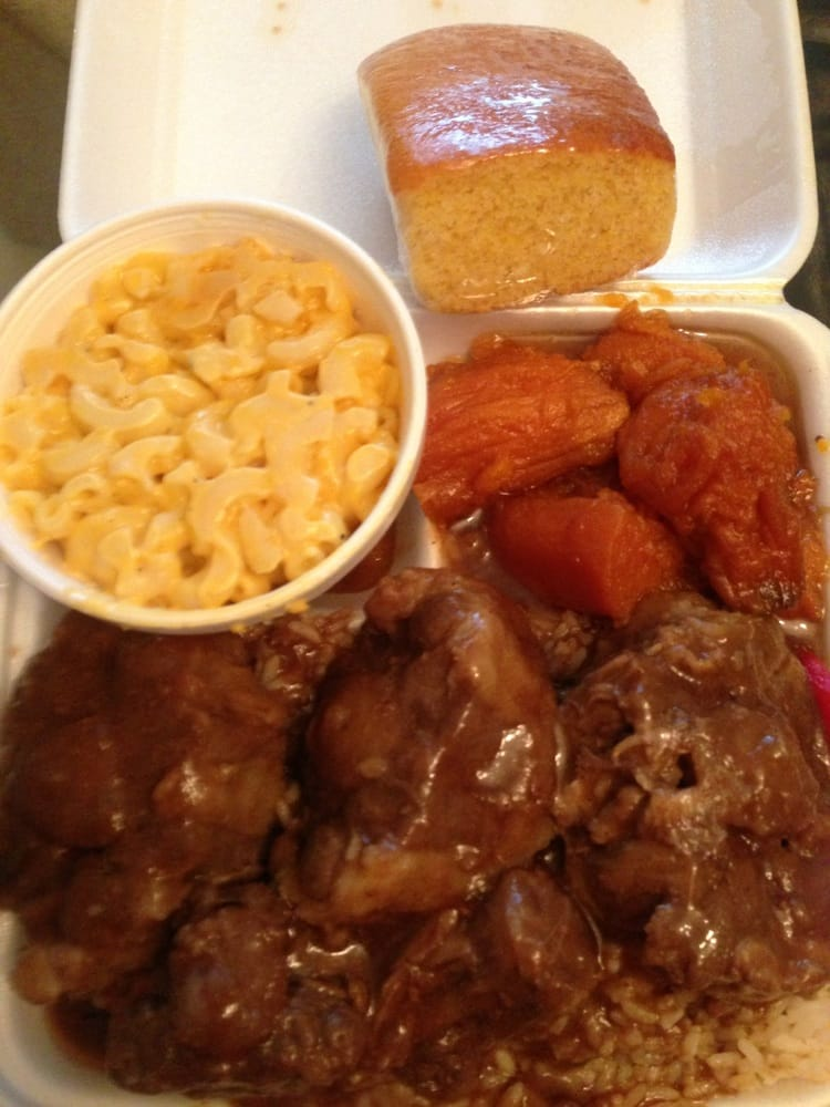 Oxtails Over Rice Mac N Cheese Yams And Cornbread Yelp