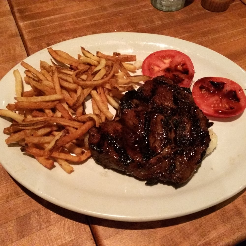 Balsamic rib eye in medium rare over a bed of mashed potatoes and ...