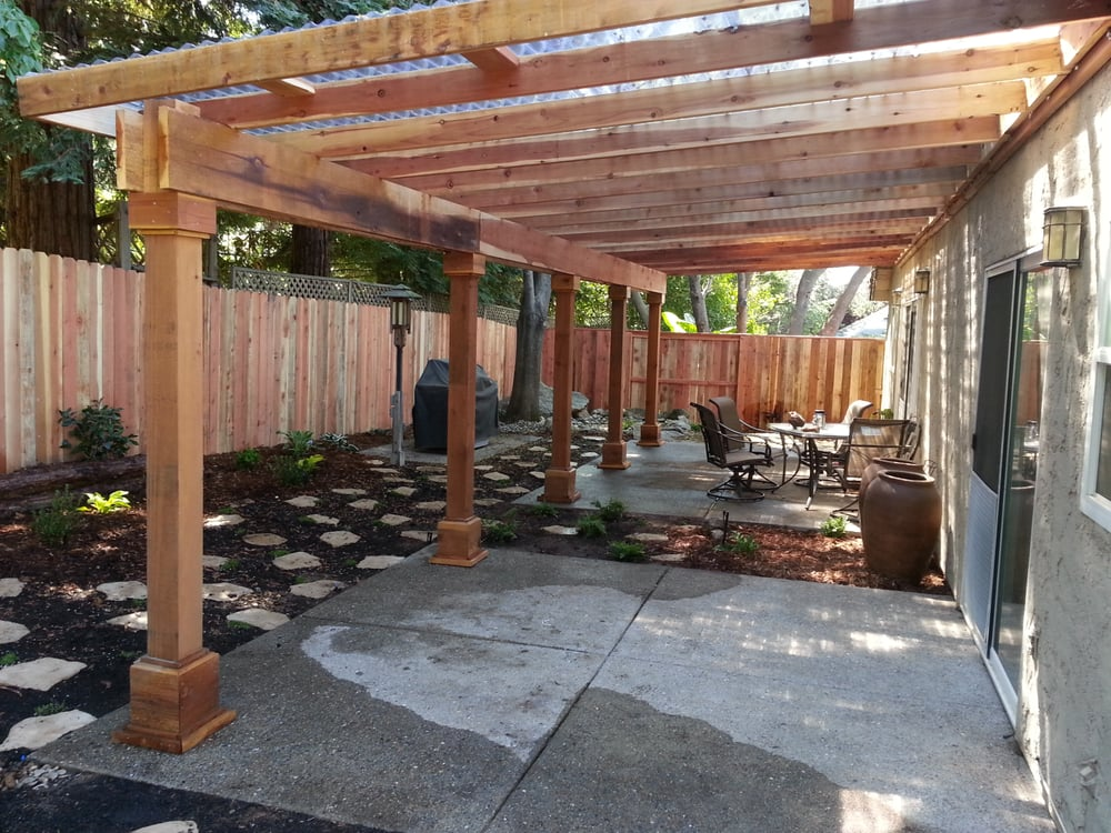 A water efficient back yard with a redwood pergola that has clear corrugated plastic for a roof - Pergola with roof ...