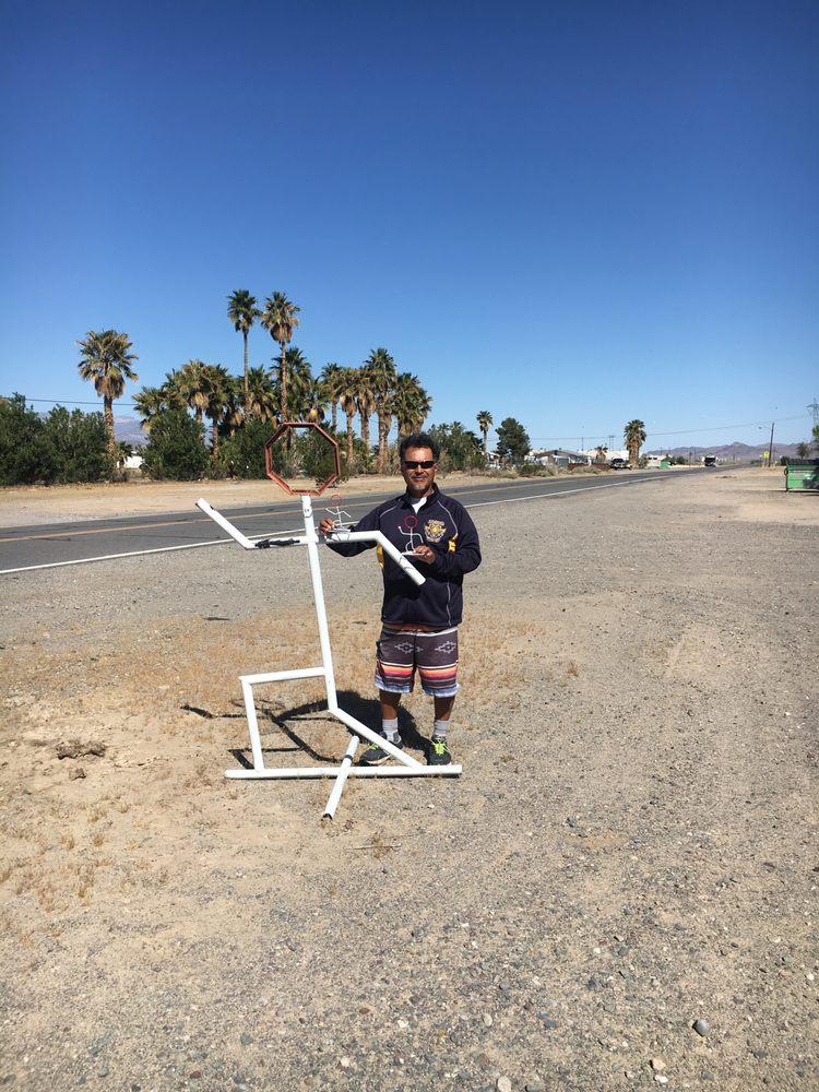 Running Man Statue: 72100 Schoolhouse Ln, Baker, CA