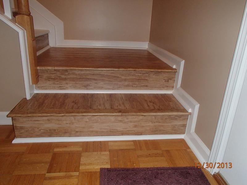 Laminate Stair Case With White Quarter Round Accents And