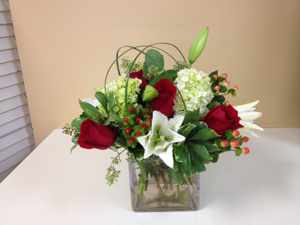 Square cube glass vase with red roses green hydrangea