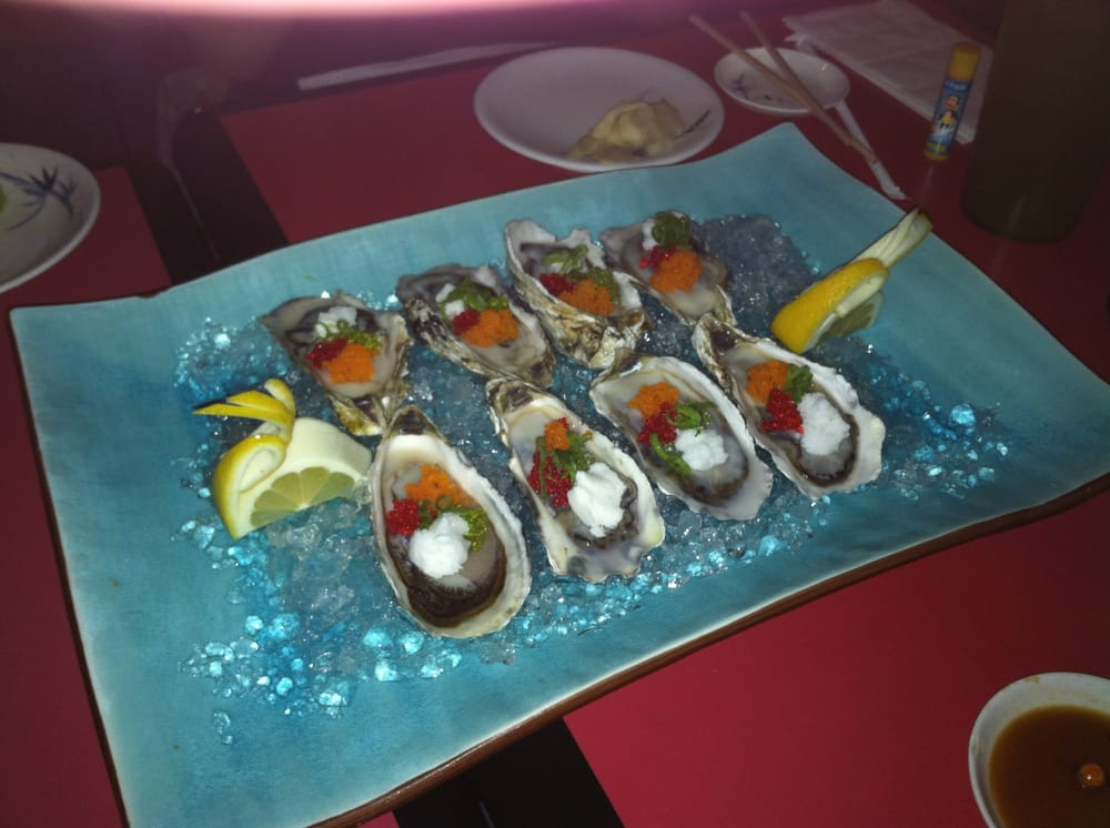 Fresh raw oysters topped with fish eggs and lychee sorbet for Fish eggs on sushi