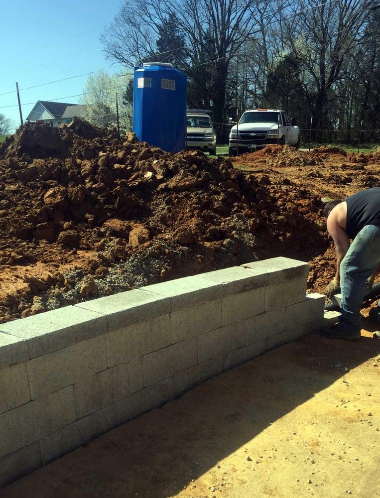 Built Versa Retaining Wall Around Parking Pad And