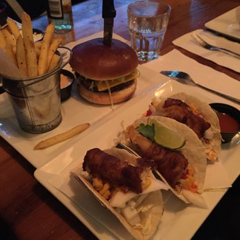Photo of Le Warehouse - Montreal, QC, Canada. BBQ Burger and Fish Tacos