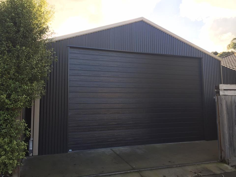 Photo of Everlift Garage Doors - Carrum Downs Victoria Australia. Woodgrain texture Colorbond Sectional & Woodgrain texture Colorbond Sectional Door in Monument - Yelp