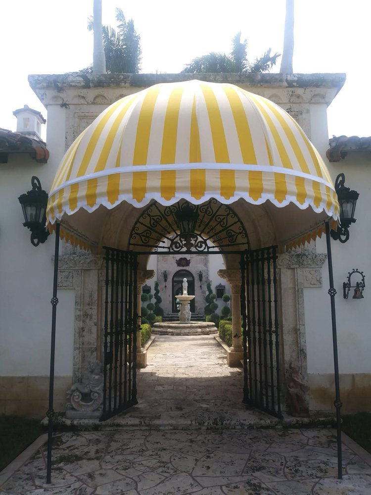 Striped yellow and white dome shaped awning with frame - Yelp