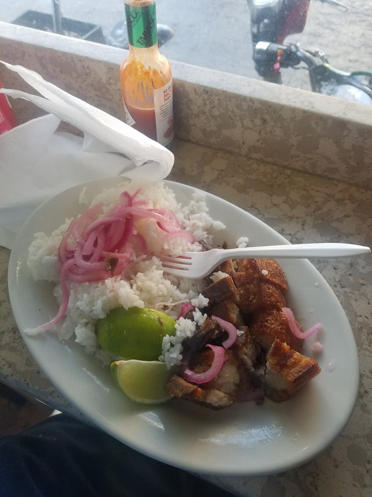 Rice with chicharon and pickled onions  Make sure to ask for