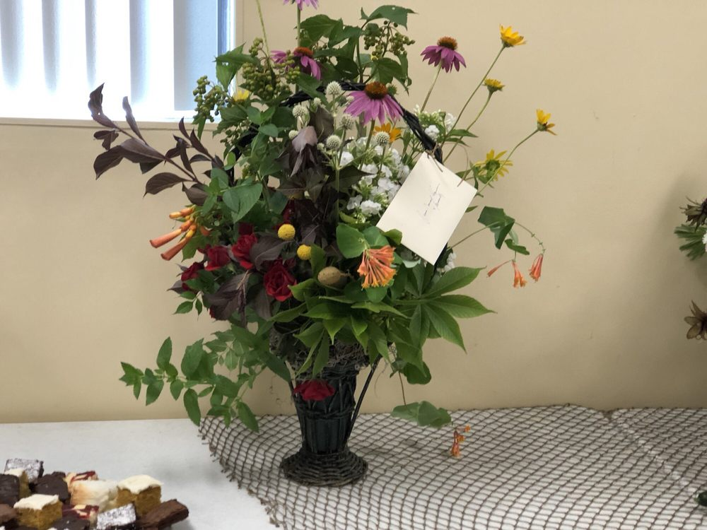 Photo of Clementine Flowers - Red Wing, MN, United States. Vintage funeral  basket