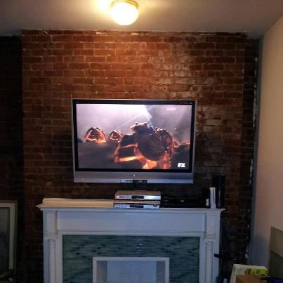 Brick wall mounted tv on tilt mount above fireplace yelp - Tv wall mount over fireplace ...