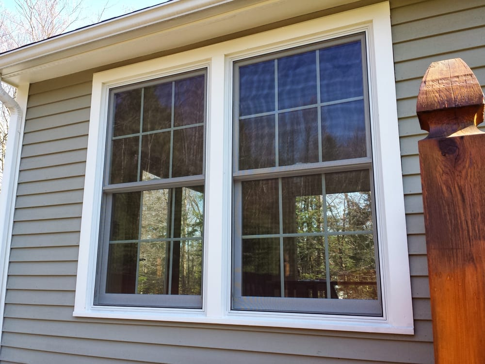 Double Hung Windows That Are Mulled With Grilles Between