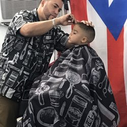 Photo of Moise's Latin Cuts - Virginia Beach, VA, United States. Zack  getting