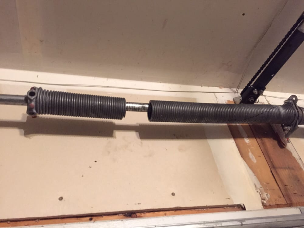 Broken spring yelp for St paul garage door repair