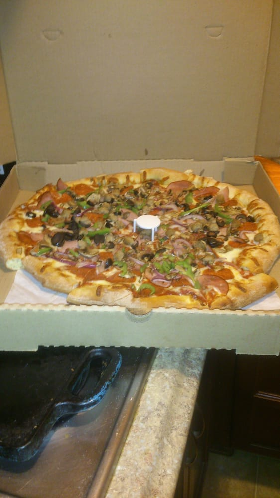 Jumbo supreme pizza. Toppings very fresh and not greasy ...