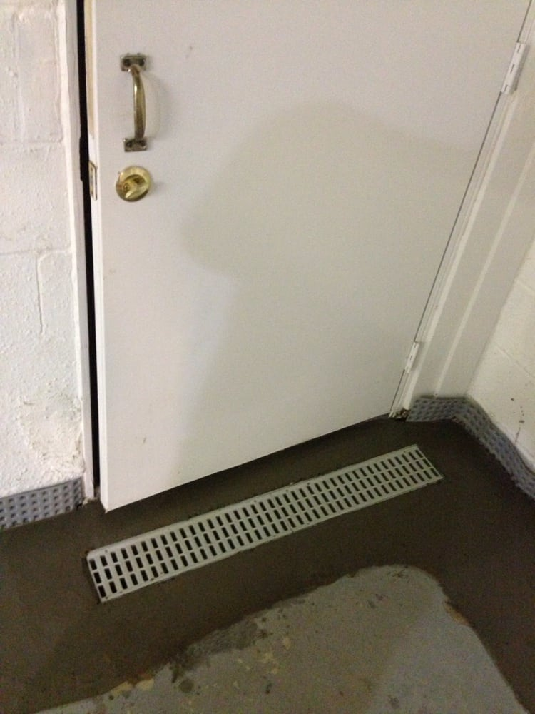 Trench Drain Installed By Bilco Doors To Prevent Water