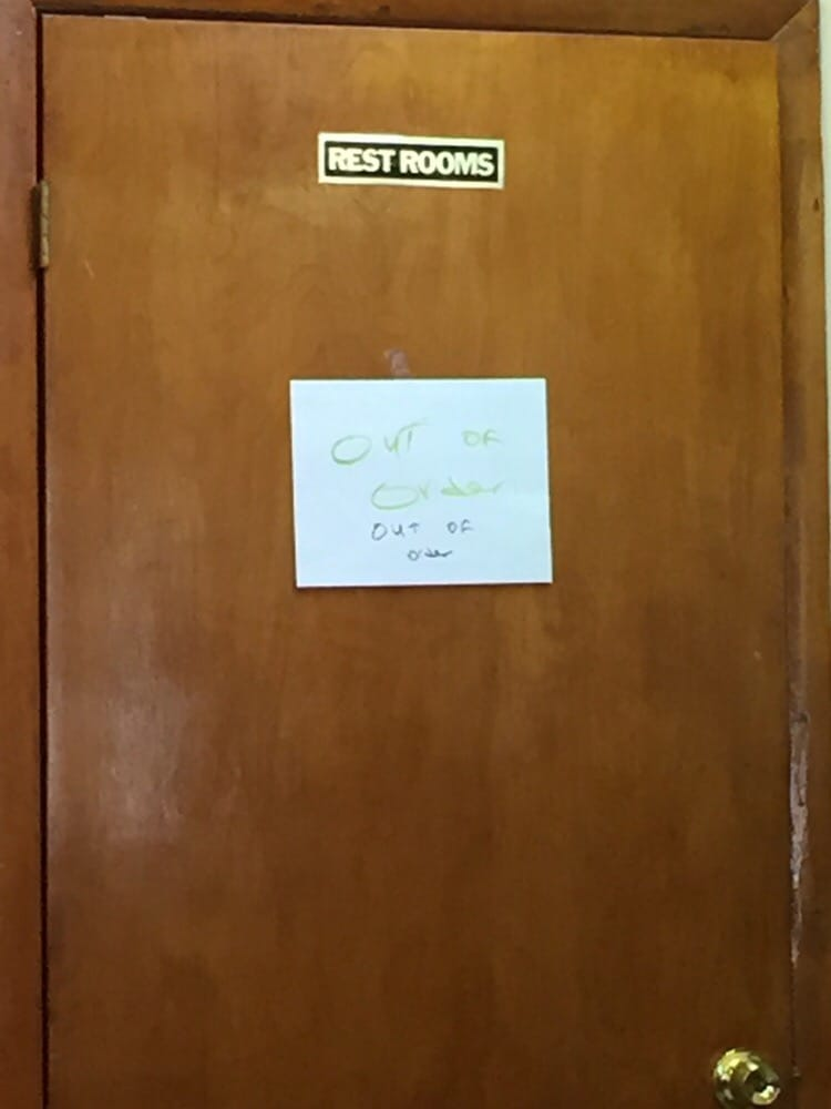 Photo of Kennedy Walk In Clinic   Tampa  FL  United States  Out. Out of order sign on the bathroom door    Yelp