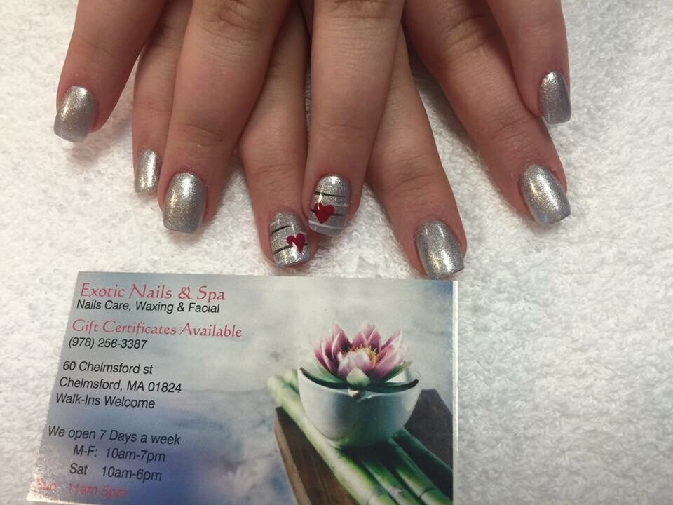 Nina did an excellent job with my (very short!) Chrismtasy nails! I ...