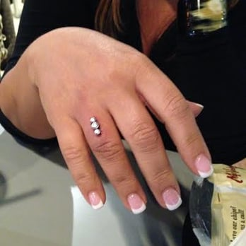 Photo Of Starlight Tattoo   Las Vegas, NV, United States. Finger Piercing By