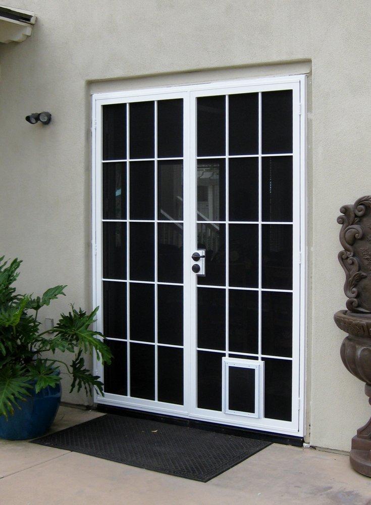 Carolina Security Screen Double Door With A Pet Door Yelp