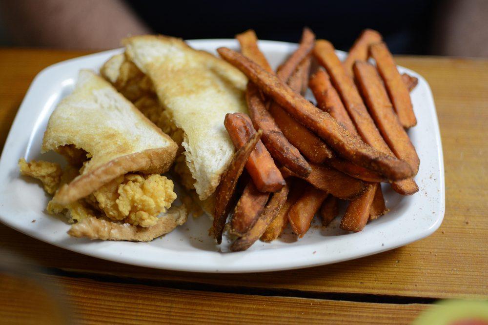 ... , LA, United States. shrimp on toast with sweet potato fries