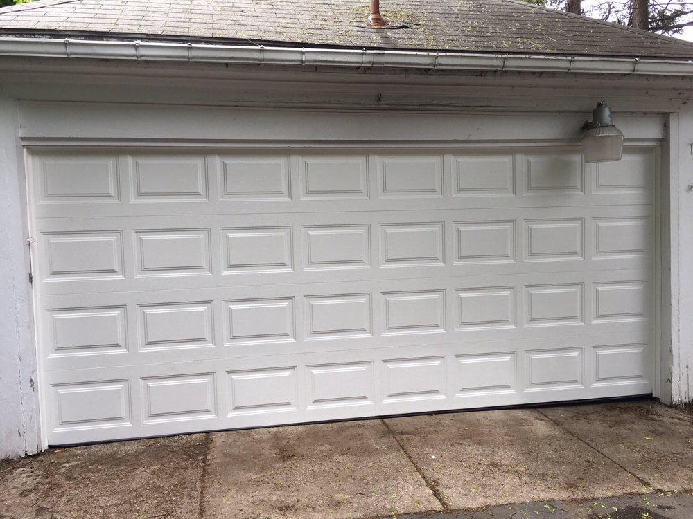 Lynoka garage door service servizi per porte di garage for 2 piedi quadrati per garage