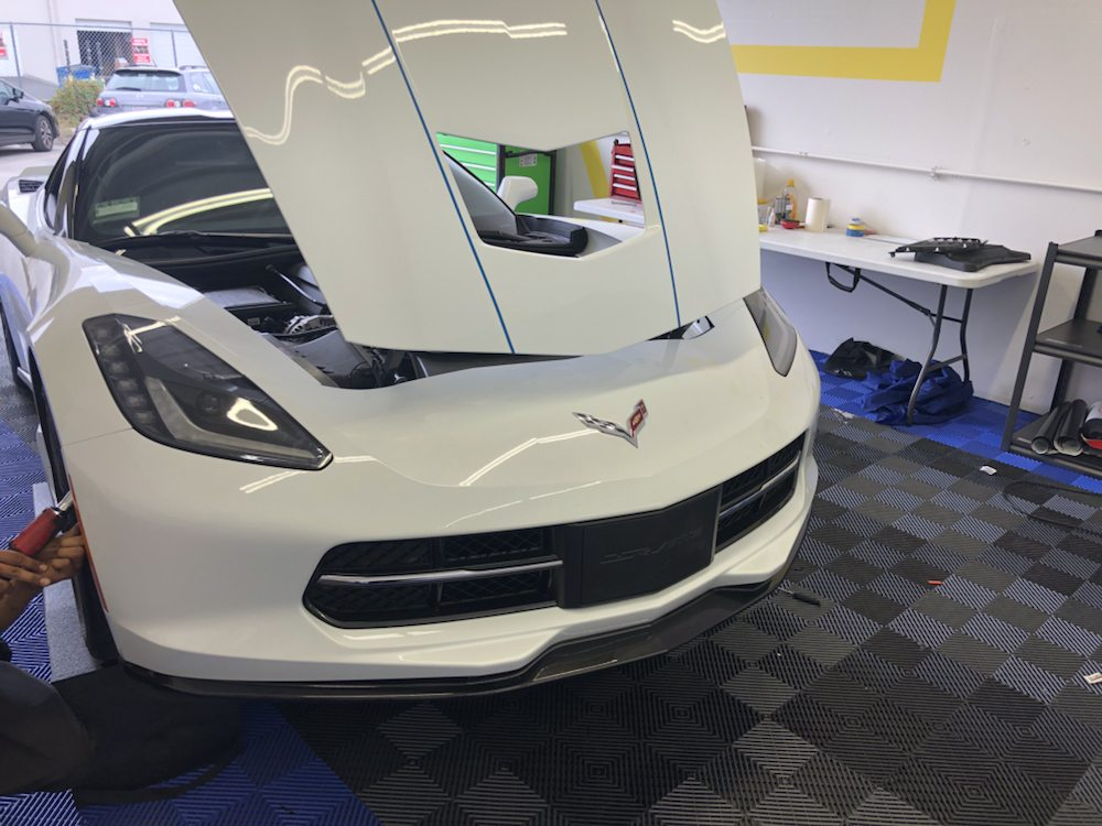 Corvette in for good wrap new center grill and Reese spoiler and