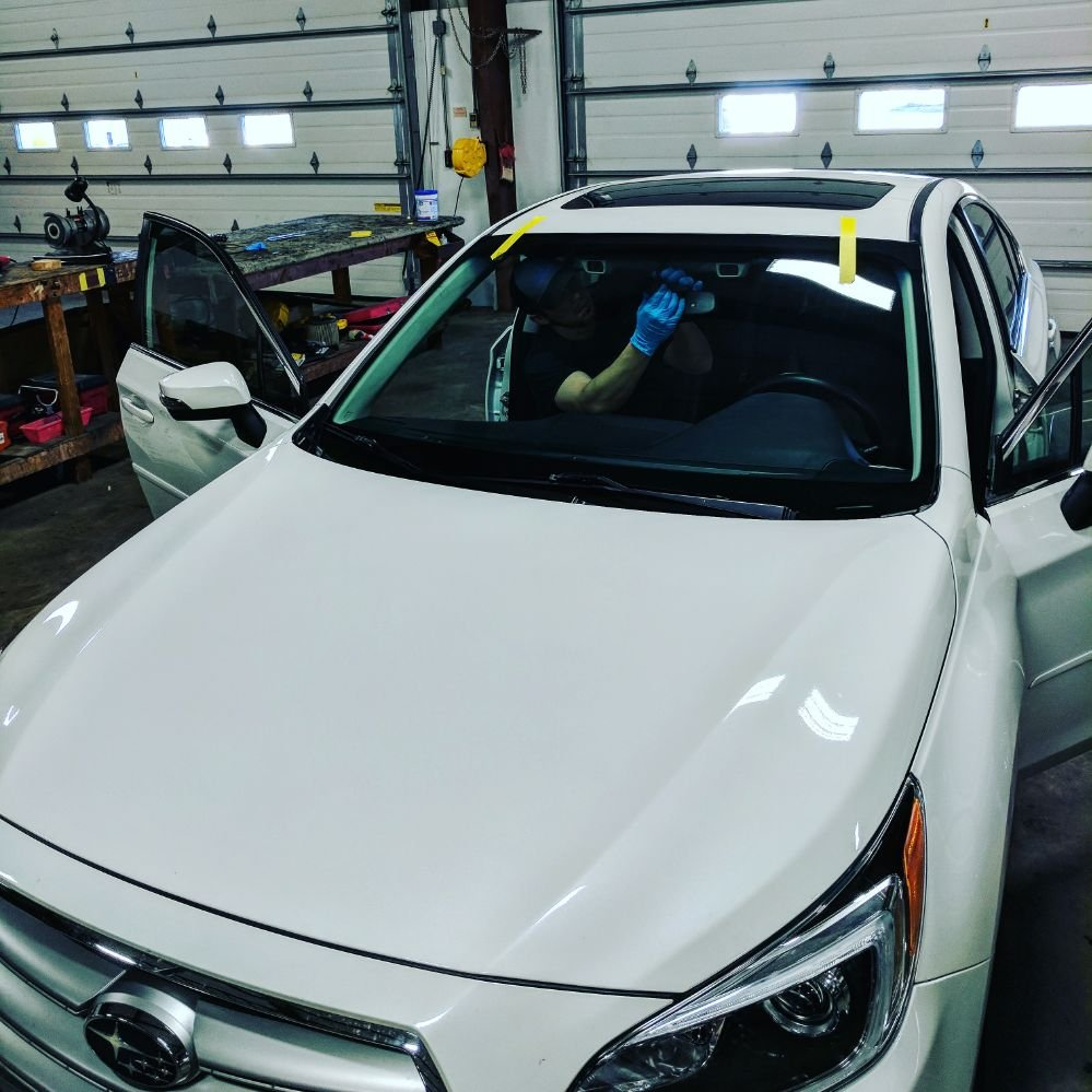 Salisbury Auto Repair Md State Inspection In Salisbury: Mike Finishing A Windshield Installation