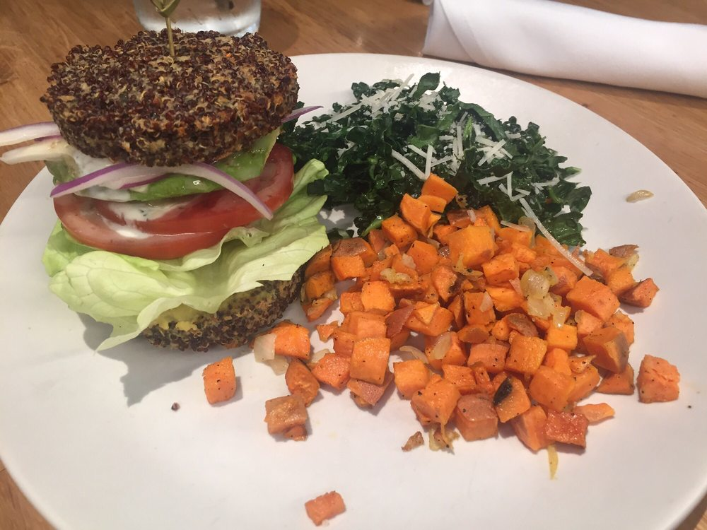 True Food Kitchen Burger inside out quinoa burger with side of half sweet potato hash and