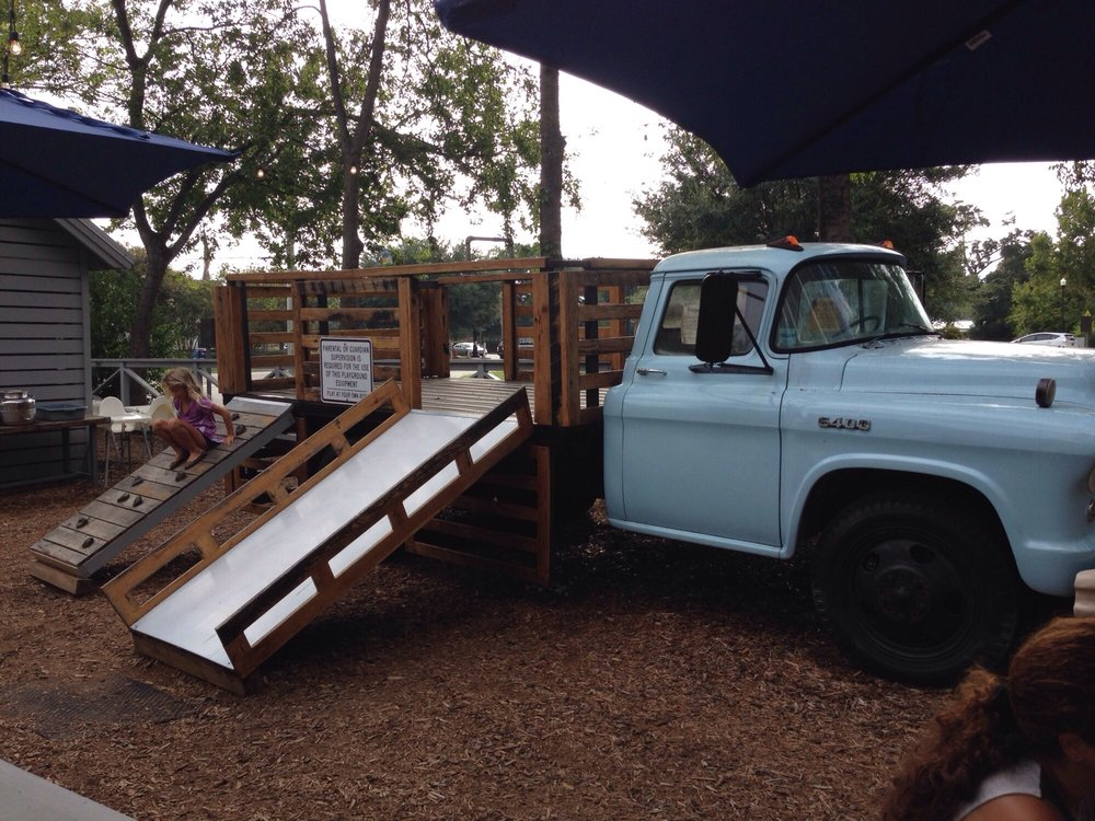 Awesome kids playground in an old truck, complete with slide and ...