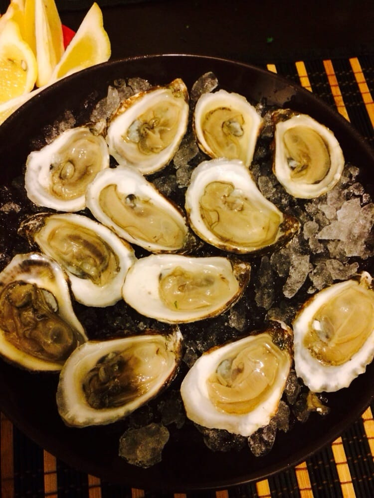 Freshly shucked oysters ask for their shucker they sell for Sunh fish sacramento