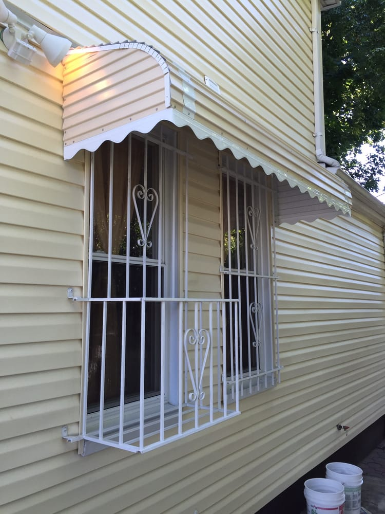 Window Bars With Air Conditioner Box And Awning To Cover