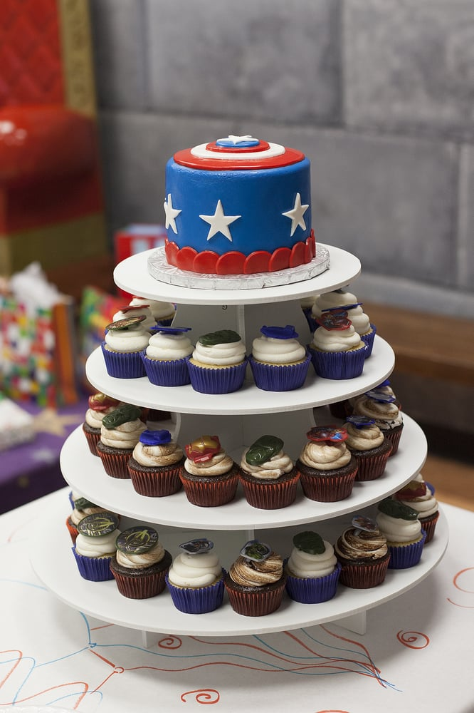Captain America cake topper and cupcakes with Avenger rings on top