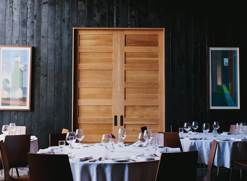 The Distillery Room, clad in charred wood paneling, is an elegant ...