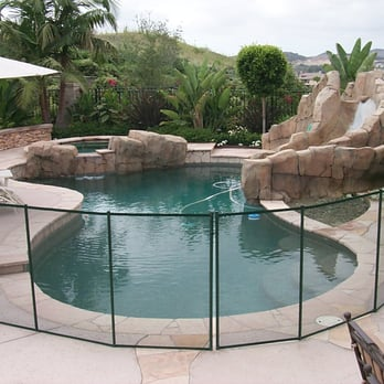 All-Safe removable mesh pool fence installed around a free-form ...
