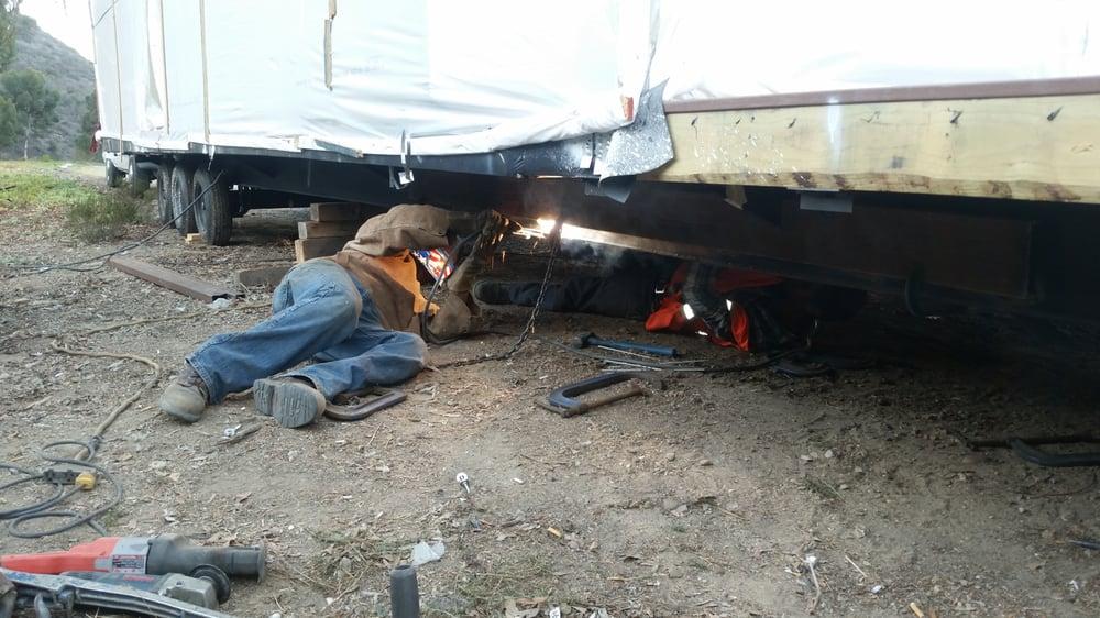 Emergency repair on the side of freeway 15. Trailer\'s 10\
