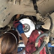 Garage Cats - Northridge, CA, United States. Cleaning the surface of the new flywheel. not all mechanics are equal :)