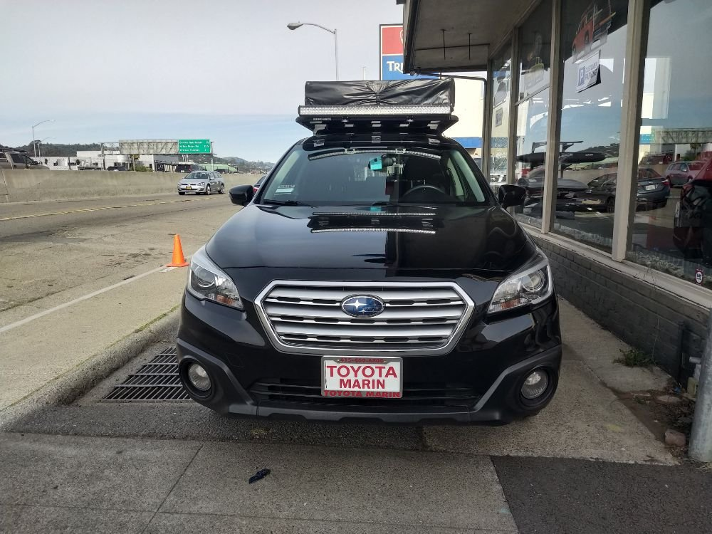 2017 Subaru outback with custom rhino rack tray and Yakima
