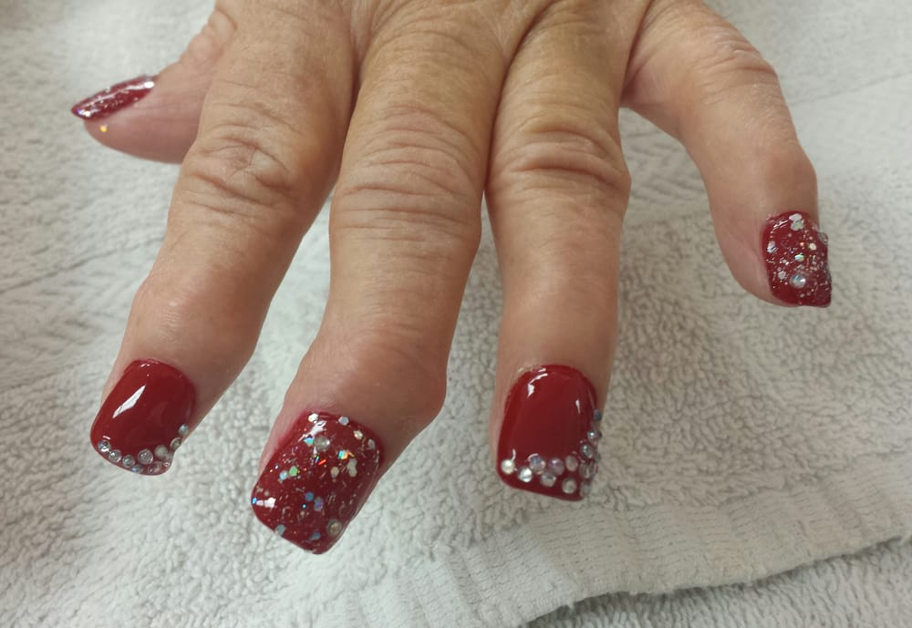 Acrylic nails with red and silver glitter polish and rhinestones - Yelp
