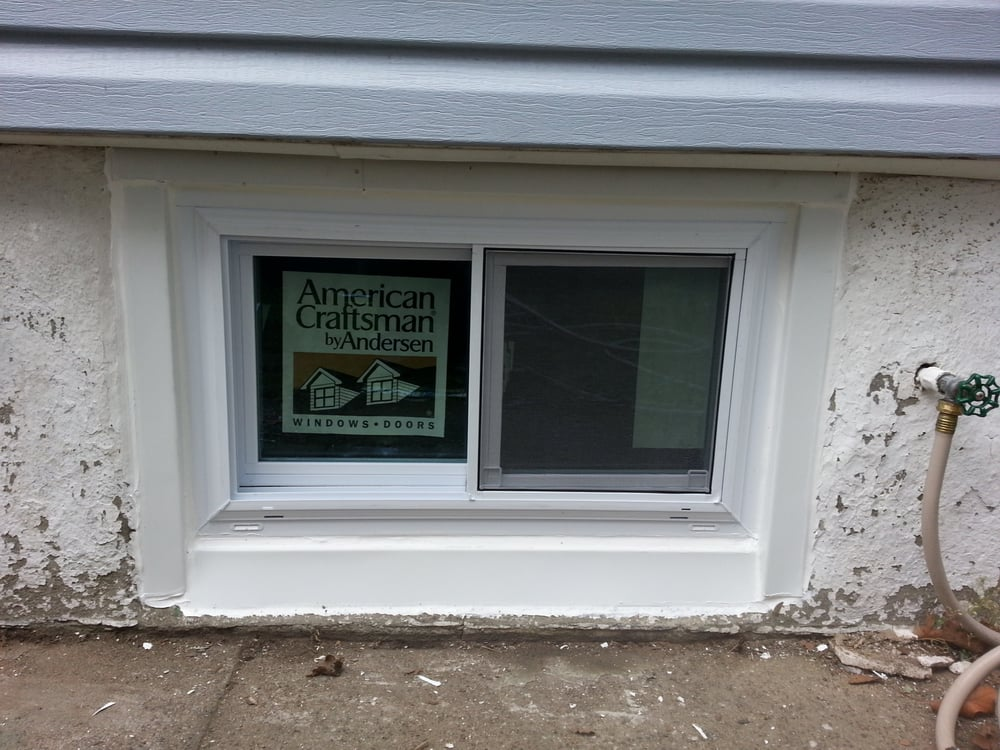 replaced old basement jalousie windows with andersen sliders with low