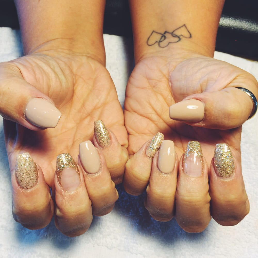 Deluxe Nail - Coffin Shape with a nude color and sparkle design. - Yelp