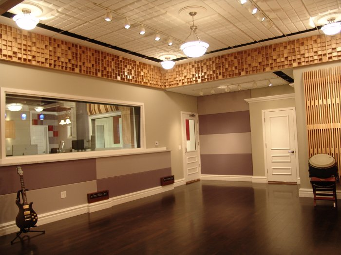 custom designed live room with acoustic window treatment ceiling