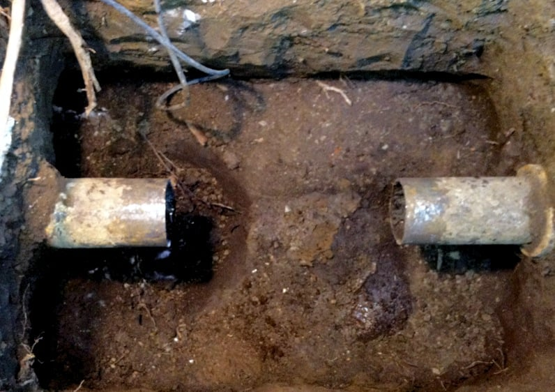 Cut cast iron main sewer drainage to install new clean