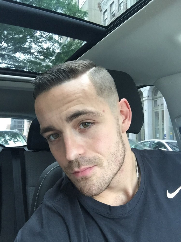 Medium fade, line up w/ comb over and razor on part - Yelp