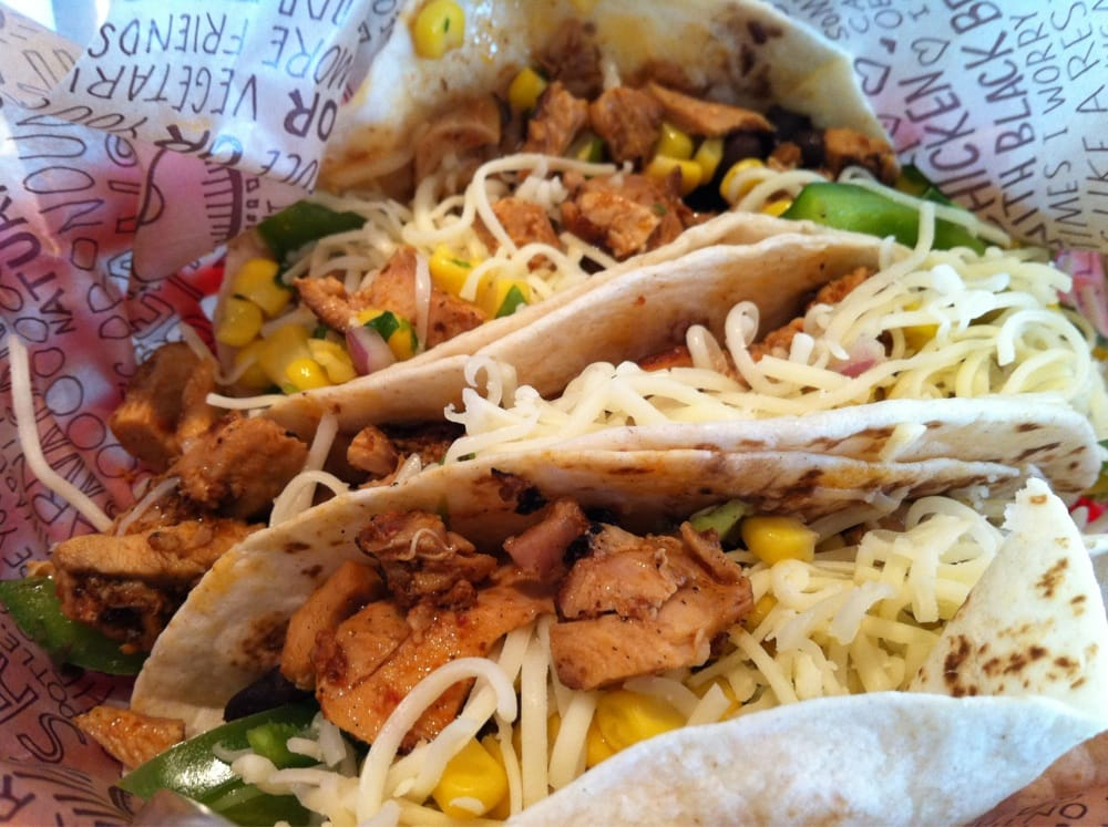 ... soft tacos with chicken, black beans, veggies, corn, and cheese