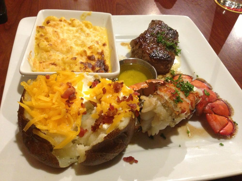 Petite sirloin and lobster tail with loaded baked potato and Mac and cheese! - Yelp