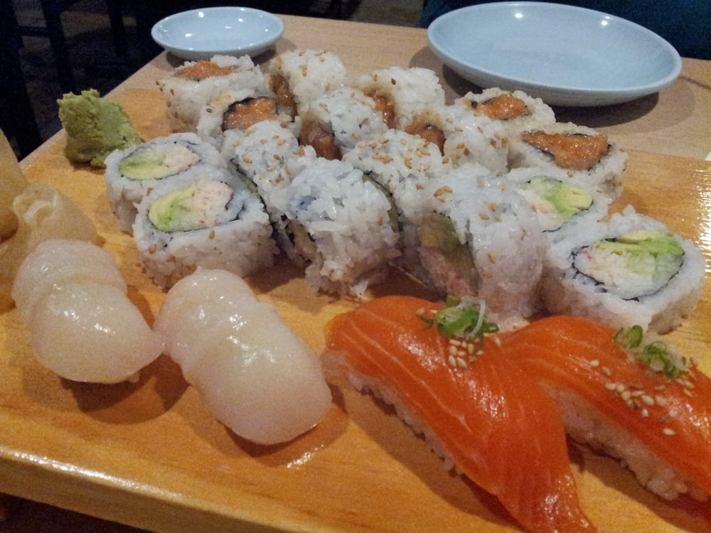 Snow crab roll, spicy yellowtail, salmon nigiri, and ...